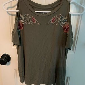 Shirt with cut out shoulders